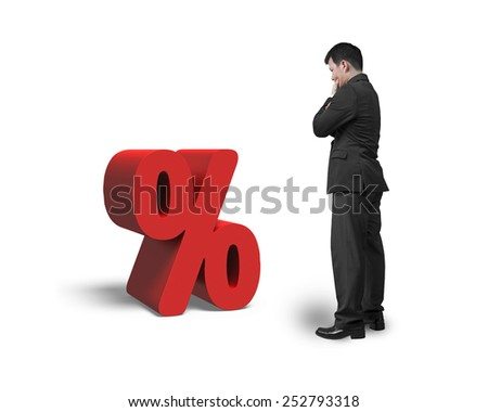 Thinking salesman looking at red percentage sign isolated on white background - stock photo