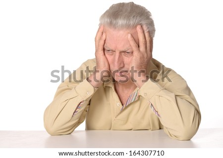 Thinking senior man on white background