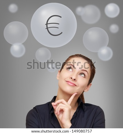 Thinking smiling woman looking up on euro sign in bubble on grey background