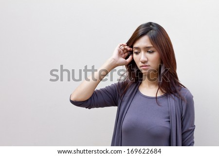 thinking woman, facing upward on plain background with text space on left side - stock photo