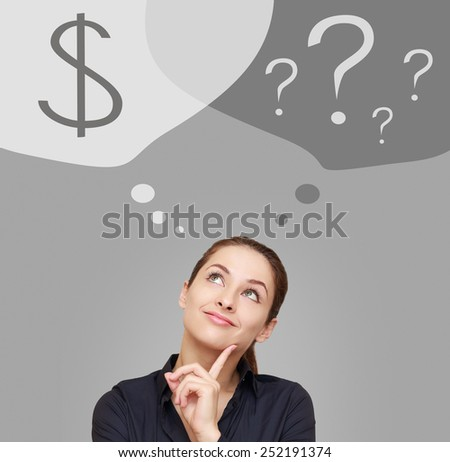 Thinking woman looking up on dollar sign in bubble. Money concept on grey background - stock photo
