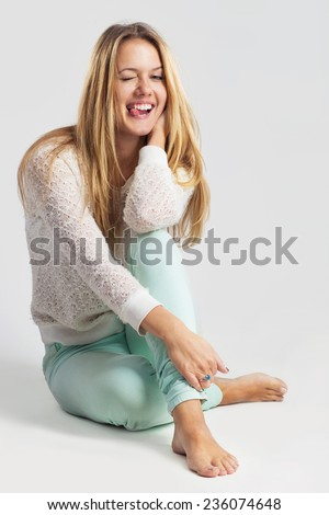 Thinking woman sitting on floor isolated on white background