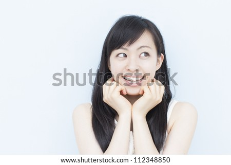 thinking woman thinking, against pale blue background - stock photo