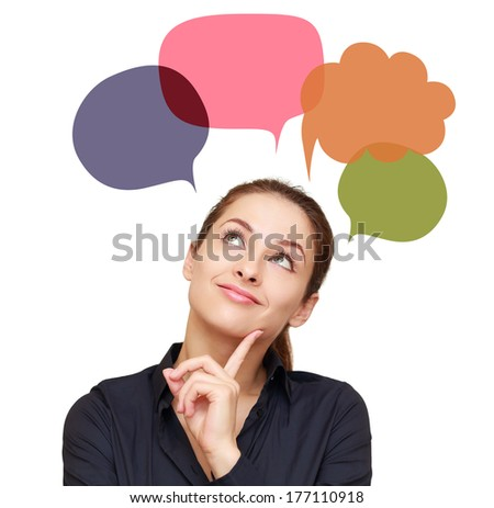 Thinking woman with many colorful chart bubbles above isolated on white background - stock photo