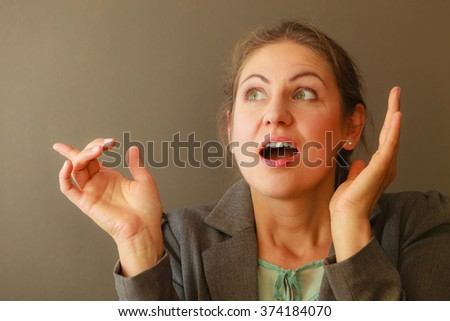 Thinking wondering mature woman. Head full of ideas and concerns. Human facial emotion and reaction.  - stock photo