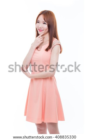 Thinking young asian girl sitting on the floor with laptop isolated on white background. - stock photo