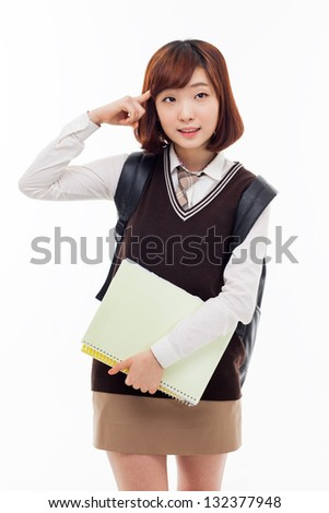 Thinking young Asian student isolated on white background. - stock photo