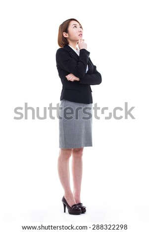 Thinking young Asian woman full shot isolated on white background - stock photo