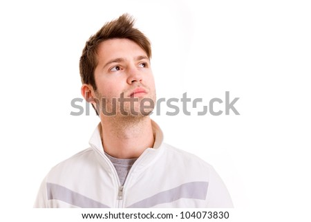 Thinking young man looking up on white background - stock photo