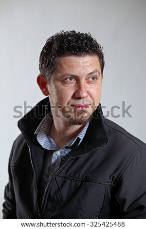 Thinking Young Man on the gray background - stock photo