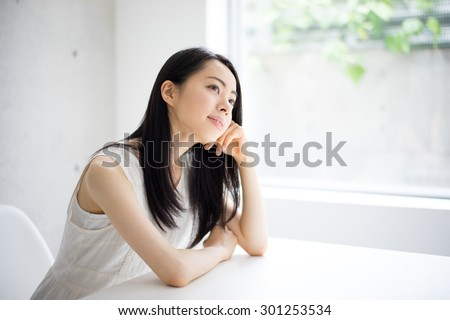 thinking young woman - stock photo