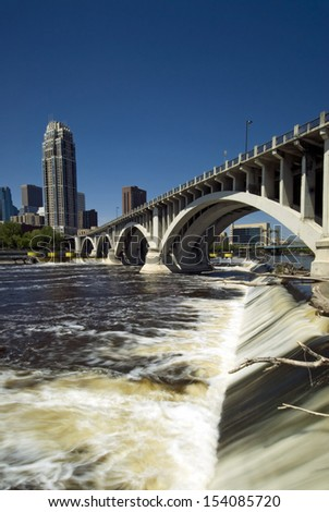 Third Avenue Bridge, (Central Ave bridge) above Saint Anthony Falls. Minneapolis, Minnesota, USA  - stock photo