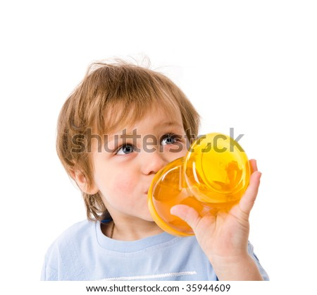 thirsty boy drinking from bottle isolated on white