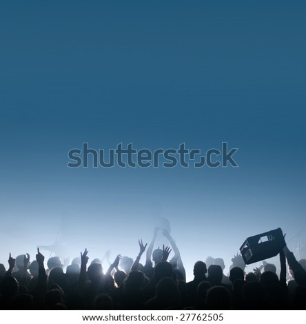 Thirsty concert crowd passing a beer crate / beverage case, fans raising hands at a concert, with copy space