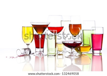 Thirteen different glasses filled with colorful drinks