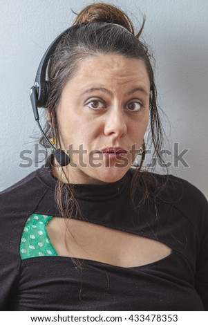 thirty something phone agent with headset with oh face