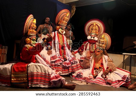 THIRUVALLA, INDIA - NOV 06: Kathakali artists perform on stage during a temple festival on November 06, 2010 in Thiruvalla, Kerala, India. Kathakali is the traditional classical dance of Kerala