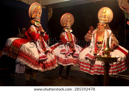 THIRUVALLA, INDIA - NOV 06: Kathakali artists perform on stage during a temple festival on November 06, 2010 in Thiruvalla, Kerala, India. Kathakali is the traditional classical dance of Kerala - stock photo