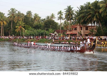 THIRUVALLA, INDIA - SEPT 09 : Oarsmen of a snake boat teams participate in the Pumba Boat race on September 09, 2011 in Thiruvalla, Kerala, India. - stock photo