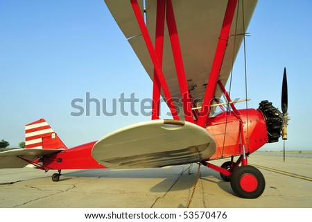 This antique red biplane is similar to those of the barnstorming era - stock photo