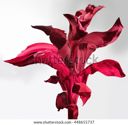 This beautiful flower is made from pieces of flying in the wind satin fabric