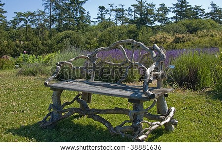 This beautiful natural seat is sitting in the middle of a peaceful garden setting with lavender in the background.