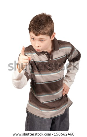This boy scolds someone with his hand on his hip and fingers pointing at the camera. - stock photo