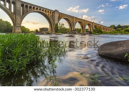 This concrete arch railroad bridge spanning the James River was built by the Atlantic Coast Line, Fredericksburg and Potomac Railroad in 1919 to route transportation of freight around Richmond, VA.  - stock photo
