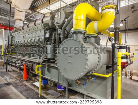 This diesel generator uses a locomotive engine as it's driver.   Stationary mounted in a building, hundreds of these are used on ships and oil rigs. - stock photo