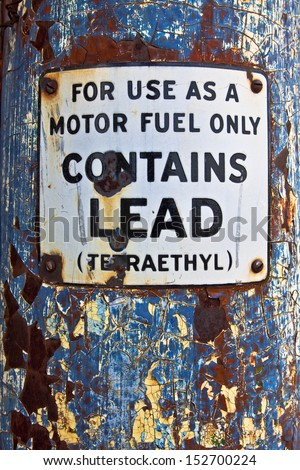 This early 1900's fuel pump has a warning sign saying for use as a motor fuel only because contains lead. - stock photo