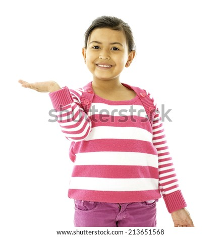 This girls is holding someting over her hand and she look happy - stock photo