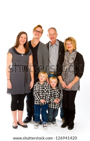 This group of six people includes three generations on an isolated white background in the studio.