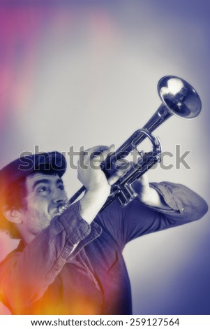 This hipster blasts on an old trumpet with stylized vintage look