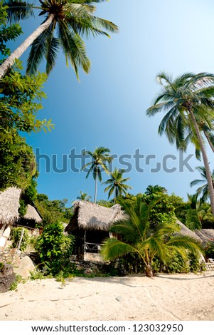 This image shows a group of beach huts in the town of Yelapa in Mexico (Near Puerto Vallarta) - stock photo