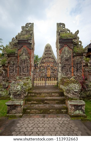 This image shows an ornate temple located in the interior of Bali