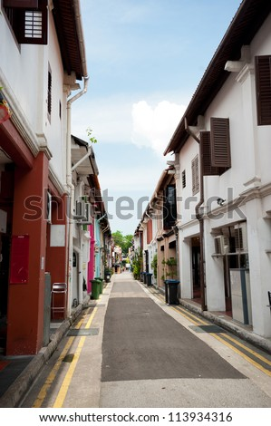 This image shows colourful alleyway shops in the Geylang area of SIngapore