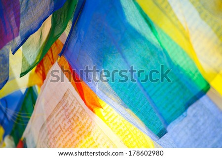 This image shows prayer flags in Kathmandu, Nepal. - stock photo