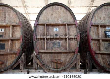 This image shows some large wine barrels in Ican, Peru - stock photo