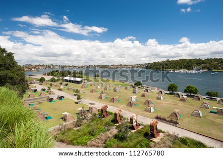 This image shows tents on Cockatoo Island,  Sydney, Australia. - stock photo