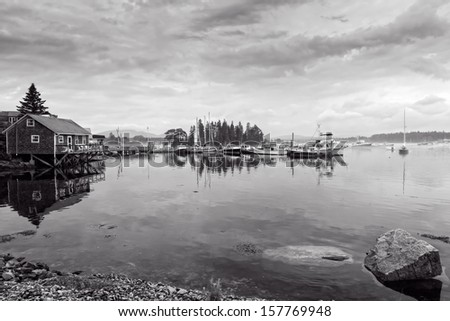 This image shows the dock and watercraft during a foggy morning at Bass Harbor, Maine. - stock photo