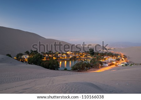 This image shows the oasis town of Huacachina, Peru at night - stock photo