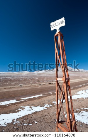 This image shows the sign post at the Bolivia/Chile border