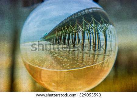 This image was taken using a crystal ball at Folly Beach, South Carolina. An additional texture was used in post processing for added creativity. - stock photo