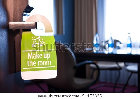 "This is a closeup of a ""make up the room"" sign - stock photo"