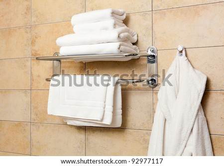 This is a closeup of a towels and bathrobes - stock photo