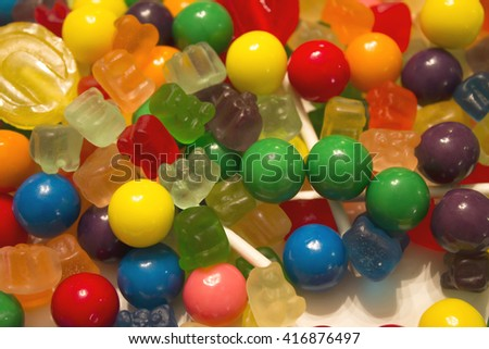 This is a closeup photograph of candy,bubblegum and lollipop background