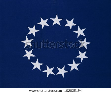 This is a flag with 13 stars sewn in a circle in a field of blue. This was the Original Colonial Flag from the Revolutionary War. - stock photo