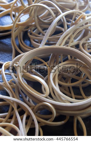 This is a photograph of rubber bands placed on a table