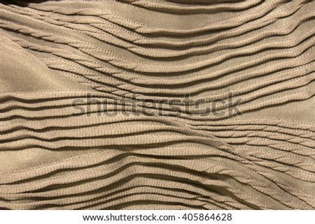 This is a photograph of Textured shiny light Purple fabric background