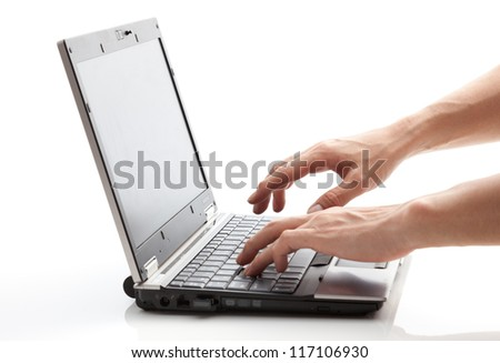 This is a picture of a person is operating a laptop.